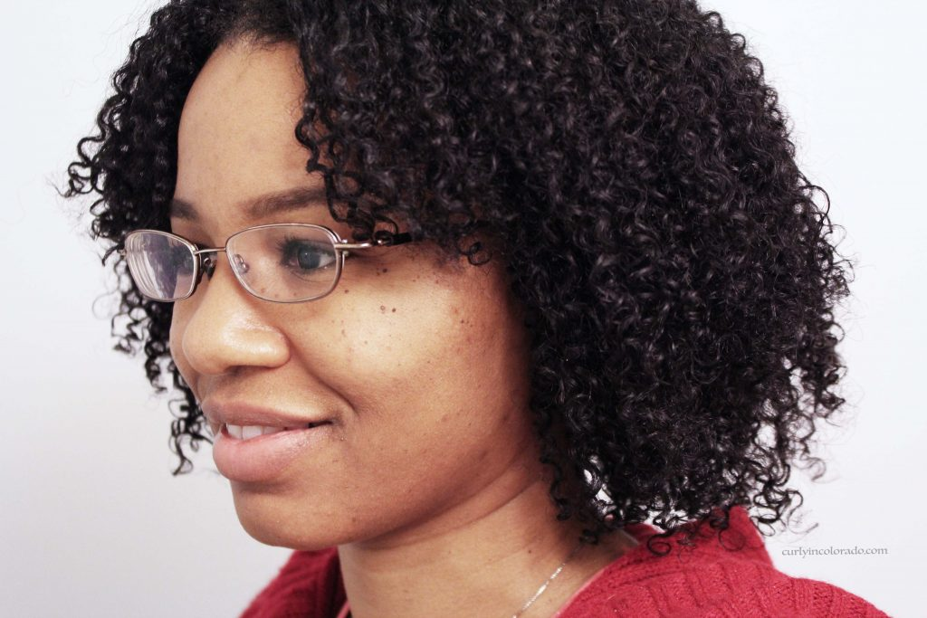 Side view of woman with naturally curly hair