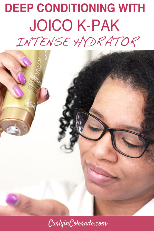 woman with natural hair using conditioner