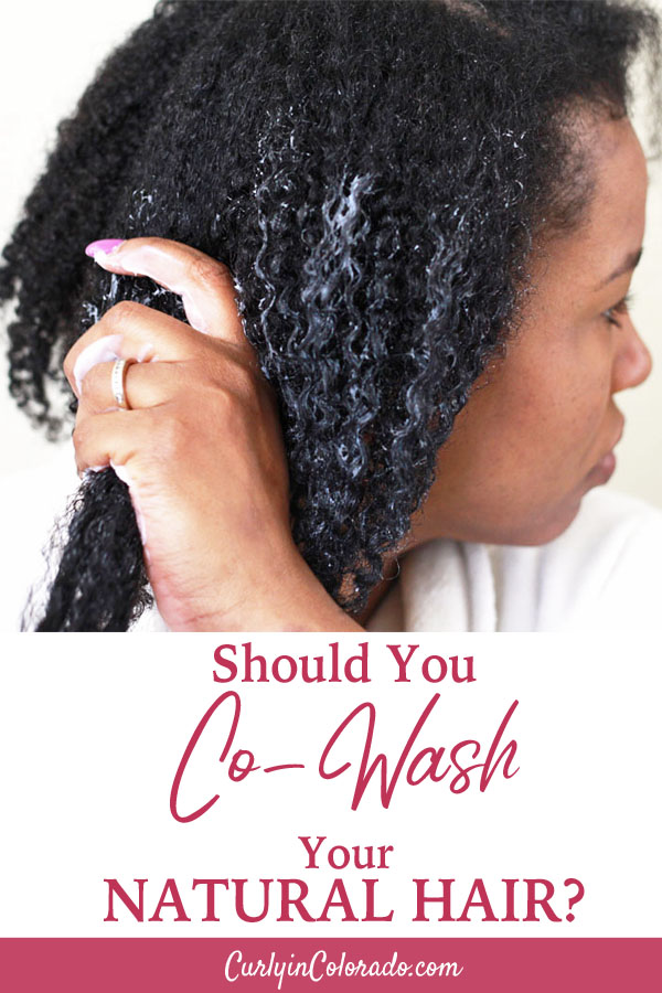 Woman using conditioner to wash natural hair