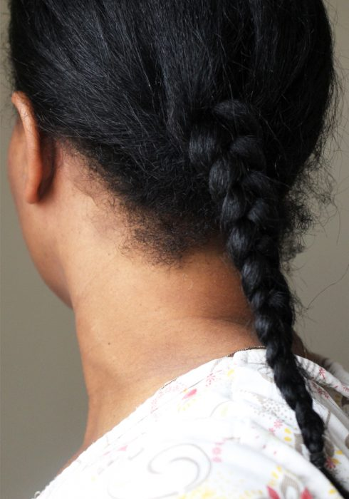 back view of single braid on straight black hair